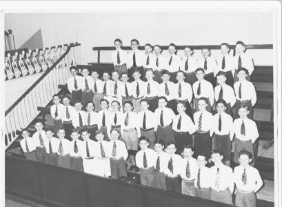 (5th or 6th, probably the latter) in Joey's primary school when we competed in the Feis Ceoil, held in the Metropolitan ​Hall, Abbey Street. We sang 'Go thoughts on Golden Wings', (real name 'Va Pensiero' form the opera Nabucco) as directed by Bro. Johnston. Back row, right-hand corner: Joe Gantly, below him is Dermot Carolan and on his right is Jim Cummins who is an architect ; Matt O'Donoghue is in the second row, 8th from the left and directly above him in the third row is John Teeling.  Photo provided by Joe Gantly.